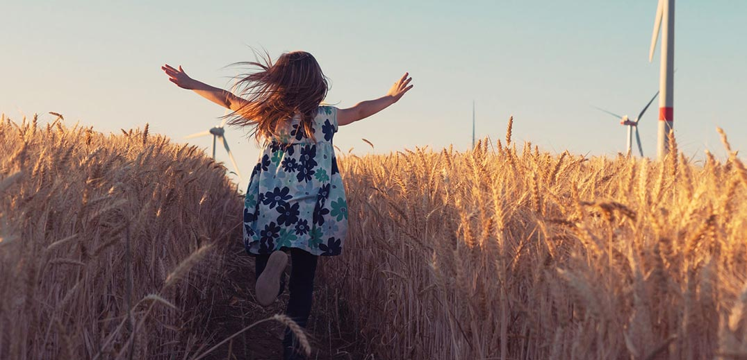 little girl running in a field
