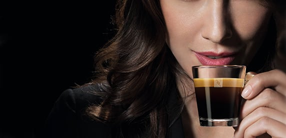 woman drinking Nespresso
