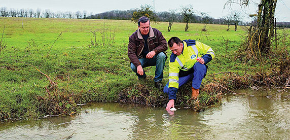 Nestlé Waters specialist takes water samples near Vittel in France