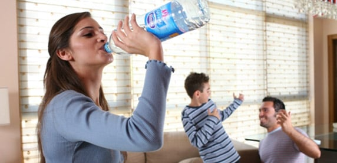 woman drinking Nestlé Pure Life