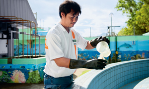A waste water treatment plant operator takes samples at our factory in Lipa in the Philippines.