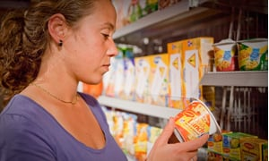 Consumer looking at a Quicklunch label