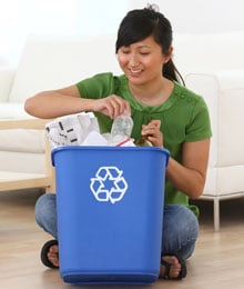Girl sorting waste packaging for recycling
