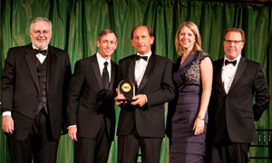 Nestlé CEO Paul Bulcke (centre) collects WEC award