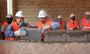 Laying the bricks of Nestlé's first factory in Angola