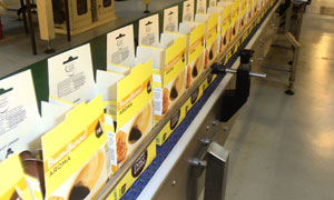 Boxes of Nescafé Dolce Gusto capsules on the factory production line