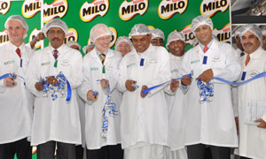 Nestlé management cutting ribbon at the opening event
