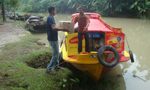 Nestlé delivery boat in Bangladesh