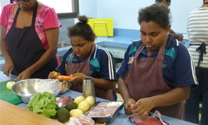 Aboriginal teenagers learning how to cook