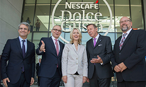 group picture in front of new Nescafé Dolce Gusto factory