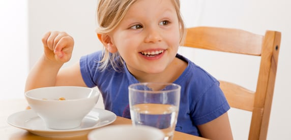 Girl eating breakfast