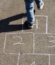 Boy playing hopscotch
