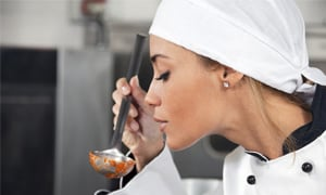 Lady tasting a sauce